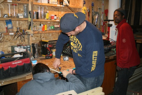 Helping make chair dollies in their wood shop