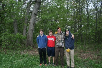 MUHS students Max Neimon, Jacob Baisden, Owen Byrne, and Sebastian Pruhs standing proudly in front of the opened up woodland