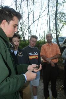 Owen Byrne releasing a mourning warbler