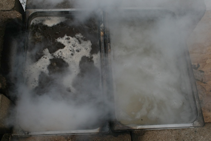 Boiling off the Sap. On the left is the concentrated syrup, Right is the Sap