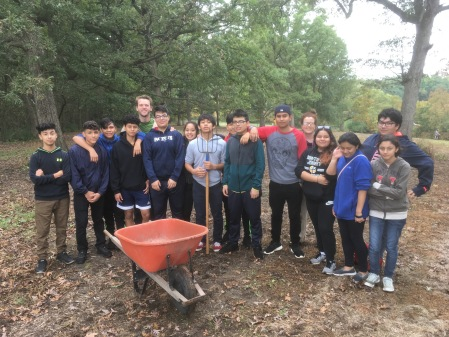 Cristo Rey High School students helping seed the prairie (and mulch a nature trail)