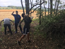 Cristo Rey High School students helping stack buckthorn