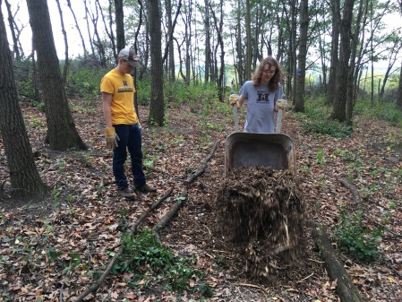 MUHS students helping mulch the nature trail